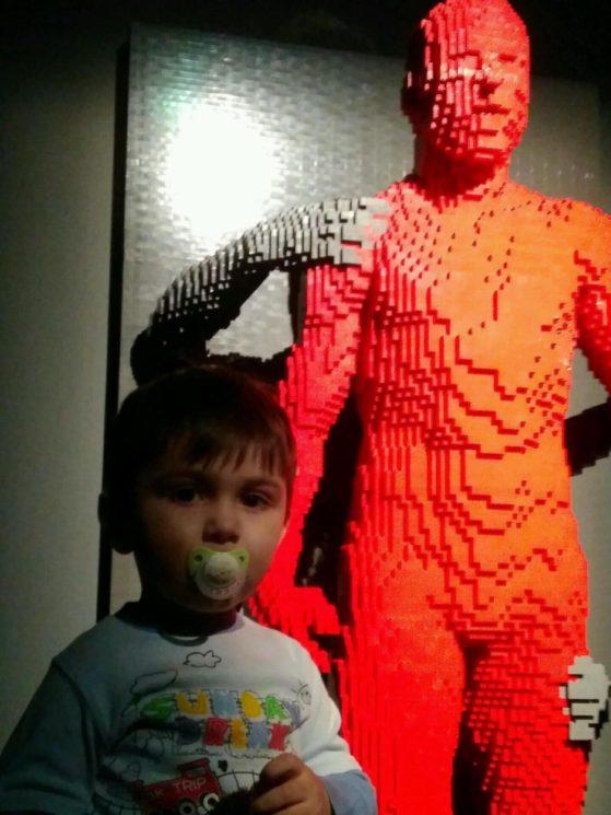 Младший сын рядом с одной из лего-фигур